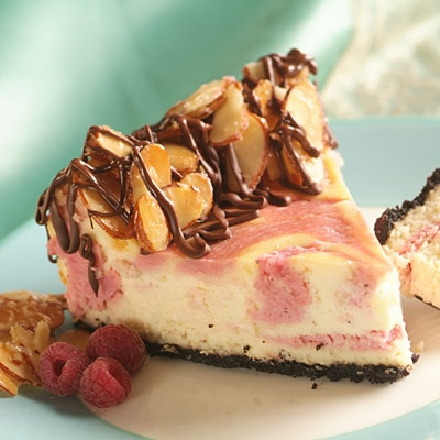 Exquisite Glazed Almond-Raspberry Swirl Cheesecake