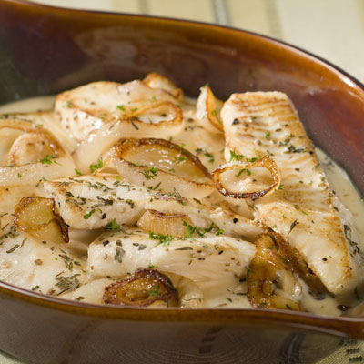 fish baked in creamy milk sauce with onions herbs recipe