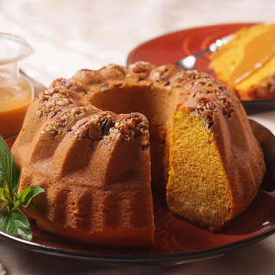 Pumpkin Pecan Bundt Cake with Spiced Caramel Sauce