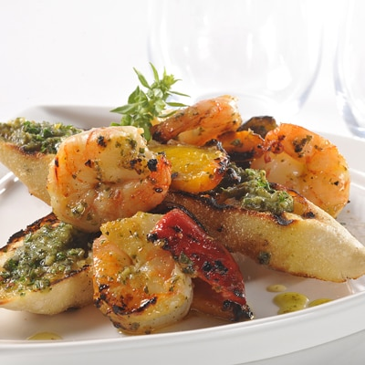 Grilled Shrimp Skewers and Roasted Peppers Basted with Basil Pesto